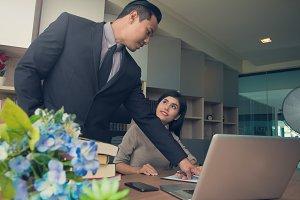 boss teaching secretary on job