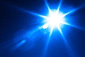 Diagonal blue glowing sun flare background