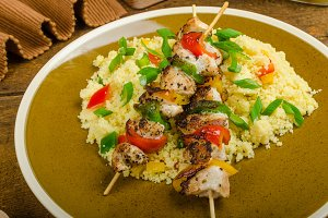 Couscous with vegetables and chicken skewer