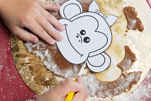 Child making christmas gingerbread