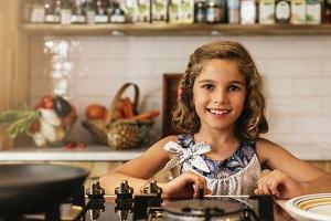 Little girl preparing cookies.