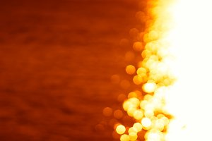 Right aligned glowing sun path ocean sunset background