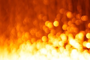 Vertical fire with orange bokeh background