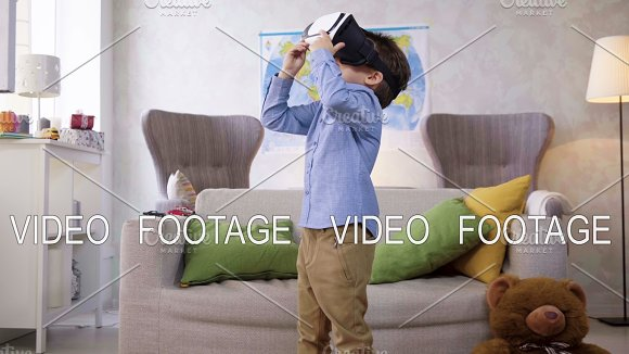 Small Child Boy Play With VR Glasses Looking Video Being Interested In And Fantasizing In Cyberspace