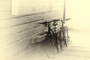 Tromso bicycle yard in sepia background