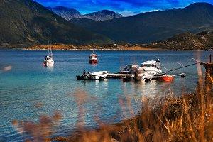Norway ships near fjord landscape background