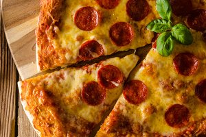 Homemade cheese pizza with salami