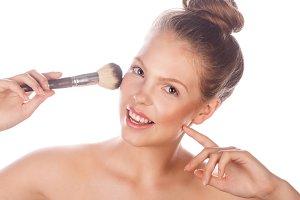 Girl holding makeup brush