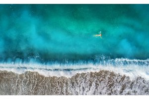 Aerial view of swimming woman in mediterranean sea
