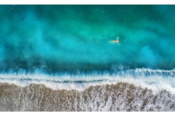 Aerial view of swimming woman in me…