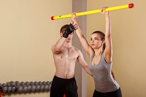 Trainer explains exercise with girl