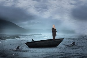 Composite image of happy businessman looking away in a sailboat