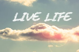 Live life against bright blue sky with cloud