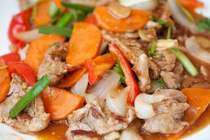 Hot salad with carrot, beef and pepper. Asian cuisine