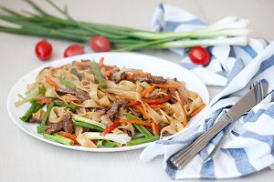 Wok. Noodles with meat and vegetables in Chinese