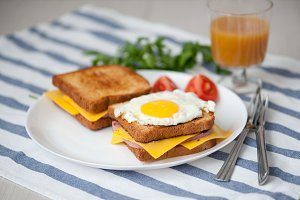 Croque Madame - sandwich with ham, cheese and fried egg