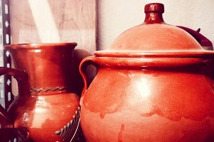 Clay pot and old jug in the pantry
