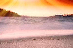 Tidal waves with light leak landscape background
