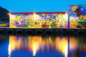 Graffiti wall in night Tromso background