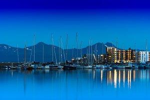 Night at Tromso yacht club city background