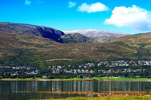 Fragment of outskirts of Tromso city background