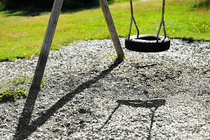 Norway children swing from tire background
