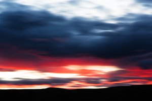 Dark red clouds bokeh background