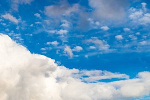 White Fluffy Clouds on Bright Blue Sky