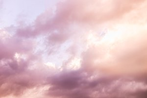 Pink Fluffy Clouds on Bright Sky