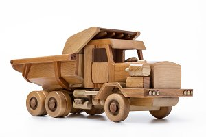 Wooden toy car on white background.