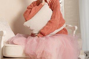 Ballerina grieves hugging pillow