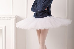 Ballerina in a warm pullover