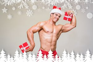 Composite image of shirtless macho man in santa hat holding gifts