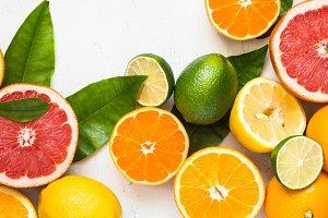 Fresh citrus fruit assortment on white.