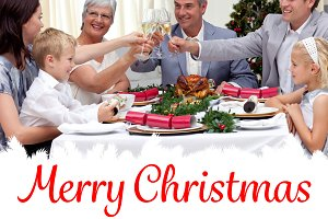 Composite image of family drinking a toast in a christmas dinner