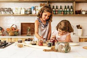 Little sisters preparing cookies.