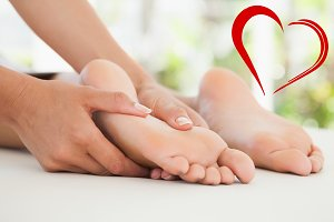 Composite image of woman receiving a foot massage
