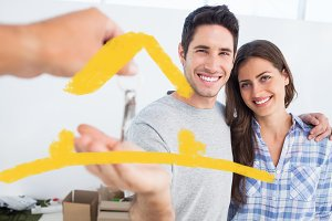 Composite image of happy man being given a house key