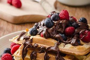 Homemade belgian waffles with fruit and chocolate