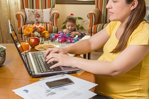 Pregnant mom working in home office