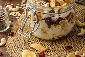 Homemade yogurt with granola, dried fruit and nuts bio