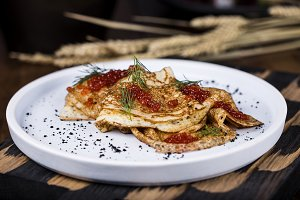 Pancakes with salmon caviar