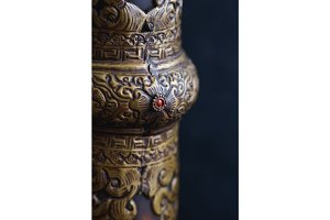 Close-up of an ornament of an old Tibetan trumpet. Religious musical instrument of Tibetan Buddhism.