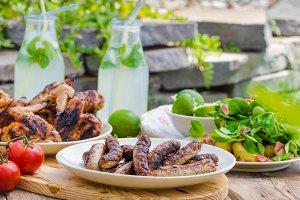 Delicious barbecue with lemonade