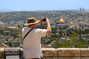 Tourist takes a photo of Jerusalem Old City view