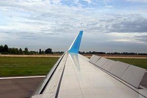 Plane is landing on runway in airport