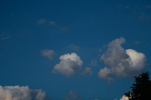 Clouds in the night sky. Starry night The photo is for a long time.