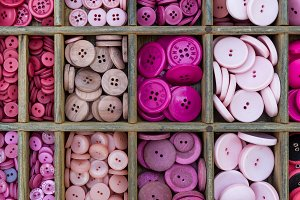 Pink buttons arranged in a drawer