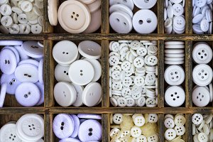 White buttons arranged in a drawer