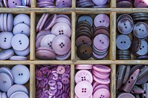 Purple buttons arranged in a drawer